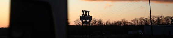 Arkansas freeway, Memphis To Little Rock, Adult store xxx sign in silhouette.