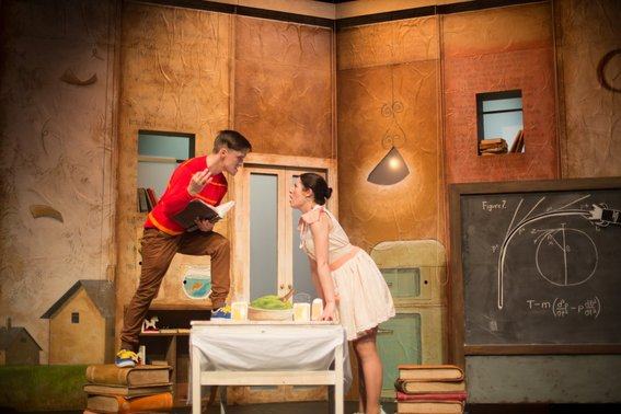Gabriel Fancourt and Madeleine Jones in The Incredible Book Eating Boy. Produced by CDP Theatre Producers. Lighting Design by Toby K.