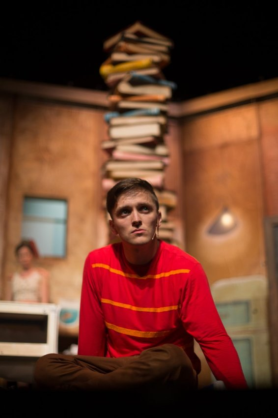 Gabriel Fancourt in The Incredible Book Eating Boy. Produced by CDP Theatre Producers. Lighting Design by Toby K.