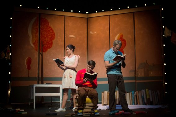 Madeleine Jones, Gabriel Fancourt and Jo Turner in The Incredible Book Eating Boy. Produced by CDP Theatre Producers. Lighting Design by Toby K.